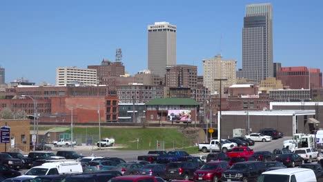 Establishing-shot-of-downtown-Omaha-Nebraska-with-[parking-lot-foreground