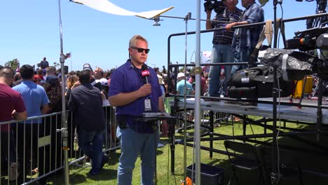 A-CNN-reporter-speaks-in-front-of-the-camera-at-a-political-rally