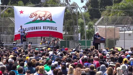 Bernie-Sanders-speaks-in-front-of-a-huge-crowd-at-a-political-rally-about-the-minimum-wage