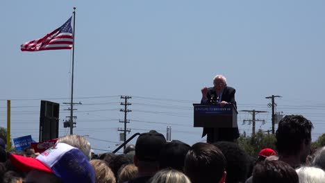 Bernie-Sanders-speaks-in-front-of-a-huge-crowd-at-a-political-rally-about-free-healthcare-for-all