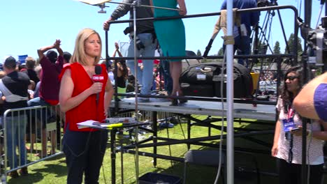 A-CNN-reporter-speaks-in-front-of-the-camera-at-a-political-rally-1