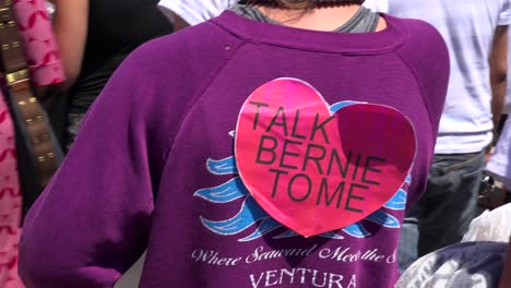 A-girl-at-a-Bernie-Sanders-rally-wears-a-sign-saying-Talk-Bernie-To-Me