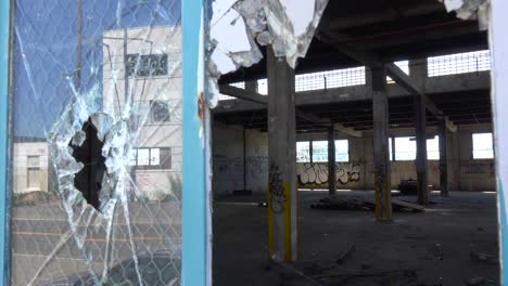 Interior-of-an-old-factory-or-warehouse-with-broken-window-foreground