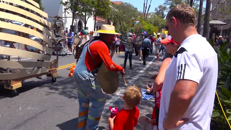Street-entertainers-amuse-the-crowds-at-the-solstice-summer-parade-in-Santa-Barbara-California
