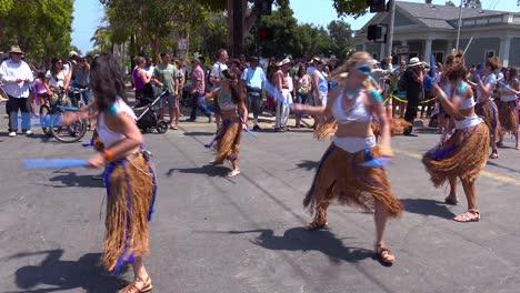 Hippies-dance-in-the-street-during-a-street-festival-in-Santa-Barbara-California-2