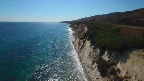 A-beautiful-long-aerial-shot-along-the-rugged-Central-California-coastline-with-sparkling-ocean