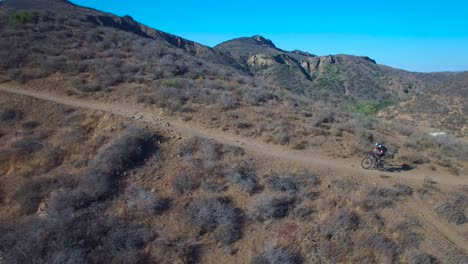 Good-aerial-following-a-mountain-biker-ascending-a-California-mountain-3