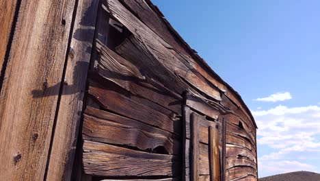 Pattern-of-old-wooden-slats-in-the-desolate-ghost-town-of-Bodie-California-1