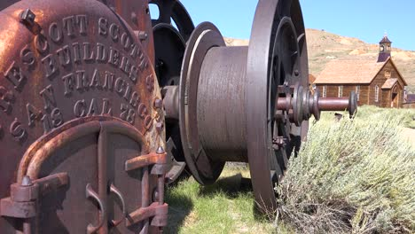 Rusted-mining-equipment-sits-on-the-ground-in-the-old-abandoned-ghost-town-of-Bodie-California