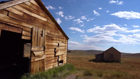 Old-wooden-barns-sit-in-the-grasslands-at-the-abandoned-ghost-town-of-Bodie