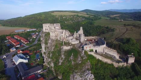 Astonishing-aerial-view-of-an-abandoned-castle-ruin-on-a-hilltop-in-Slovakia-1