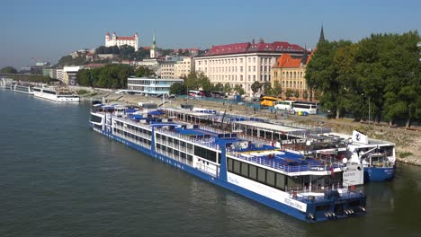 Boats-travel-on-the-Danube-River-through-the-charming-capital-city-of-Bratislava-Slovakia