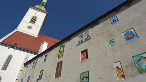 A-view-looking-up-at-the-central-cathedral-with-painted-windows-and-art-in-central-Bratislava-Slovakia