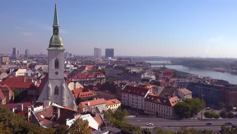Beautiful-establishing-shot-of-downtown-Bratislava-Slovakia-with-church-foreground-1