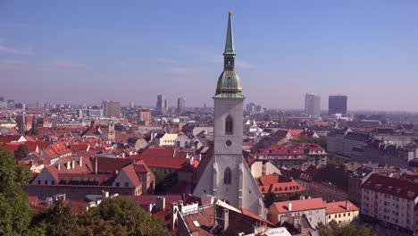 Beautiful-establishing-shot-of-downtown-Bratislava-Slovakia-with-church-foreground-2
