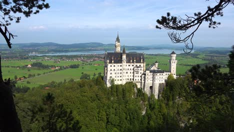 A-classic-view-through-the-trees-of-Neuschwanstein-Mad-Ludwigs-castle-in-Bavaria-Germany