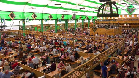 Establishing-shot-of-a-crowded-beer-hall-during-Oktoberfest-in-Munich-Germany