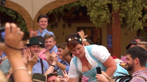A-German-woman-drinks-a-full-stein-of-beer-and-receives-an-ovation-at-Okroberfest-in-Germany