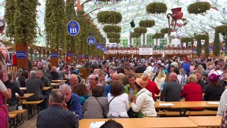 A-woman-sells-gingerbread-cookies-inside-a-beer-hall-at-Oktoberfest-Germany