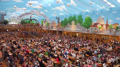 Good-tilt-down-establishing-shot-of-a-huge-beer-hall-at-Oktoberfest-Germany