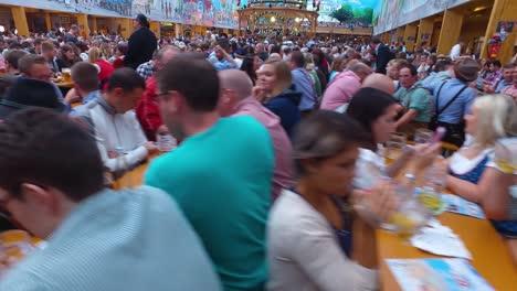 Traveling-shot-of-a-huge-beer-hall-at-Oktoberfest-Germany