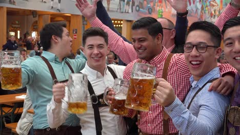 Happy-people-drink-toast-and-celebrate-at-Oktoberfest-Germany