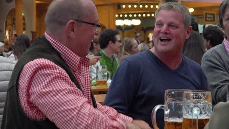 Two-men-hug-at-Oktoberfest-Germany