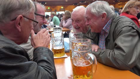 Men-have-a-discussion-at-Oktoberfest-Germany