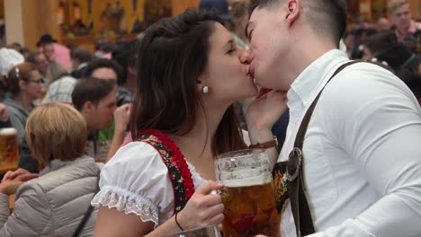 A-boy-kisses-his-girl-during-Oktoberfest-in-Germany
