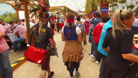 A-beer-maiden-delivers-armfuls-of-beer-at-Oktoberfest-Germany-1