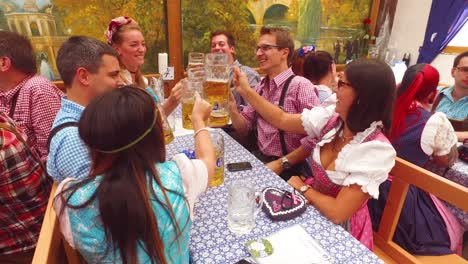 People-raise-their-beer-mugs-in-a-toast-at-Oktoberfest-Germany
