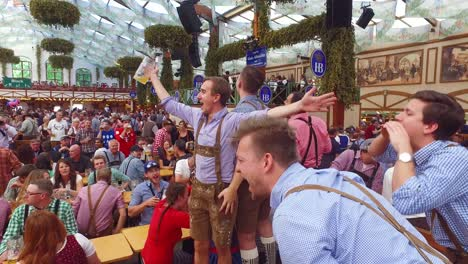 Drunken-men-celebrate-in-a-beer-hall-during-Oktoberfest-in-Germany
