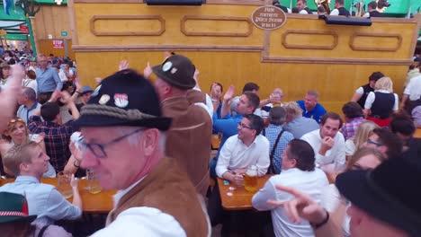 Drunken-men-celebrate-and-dance-in-a-beer-hall-during-Oktoberfest-in-Germany-1