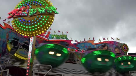 A-tilt-a-whirl-style-ride-and-an-amusement-park-spins-in-circles