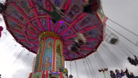 A-rotating-elevated-carnival-ride-gives-folks-a-thrill-at-an-amusement-park-or-fairgrounds