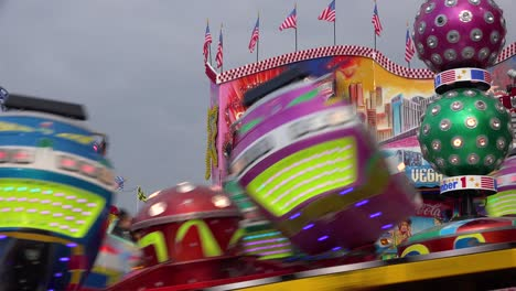 A-tilt-a-whirl-style-ride-and-an-amusement-park-spins-in-circles-1