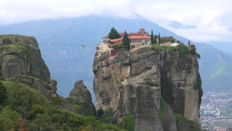 A-cable-car-moves-across-a-chasm-to-a-monastery-in-Meteroa-Greece-2
