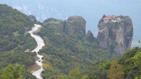 A-winding-road-leads-to-a-remote-monastery-in-Meteora-Greece