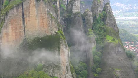 Fog-rises-around-the-cliffs-of-Meteora-Greece