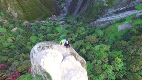 Climbers-ascend-a-sheer-pinnacle-spire-in-Meteora-Greece