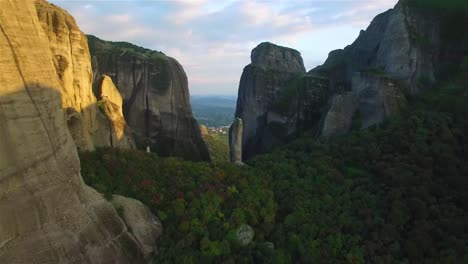 Aerial-as-climbers-ascend-a-sheer-pinnacle-spire-in-Meteora-Greece