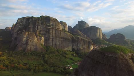 Beautiful-aerial-in-golden-light-over-the-rock-formations-of-Meteora-Greece