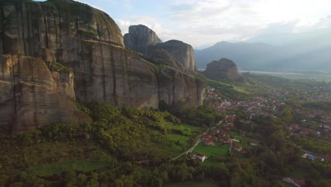 Beautiful-aerial-in-golden-light-over-the-rock-formations-of-Meteora-Greece-1