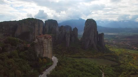 Beautiful-aerial-in-golden-light-over-the-rock-formations-of-Meteora-Greece-2