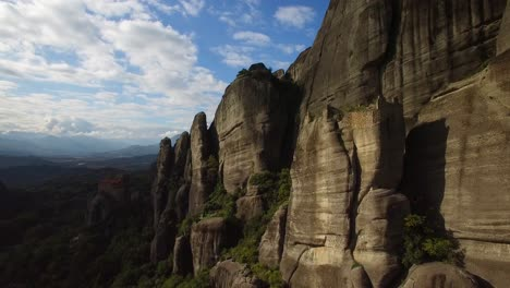Beautiful-aerial-in-golden-light-over-the-rock-formations-and-monasteries-of-Meteora-Greece