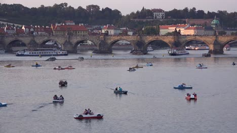 Paddleboats-move-on-the-Vltava-River-in-Prague-Czech-Republic