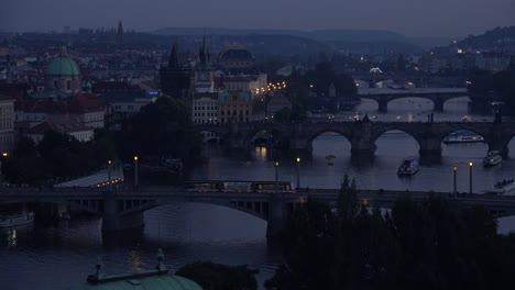 Beautiful-night-establishing-shot-of-boats-along-the-Vltava-River-in-Prague-Czech-Republic