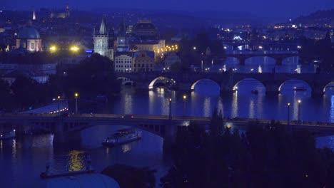 Beautiful-night-establishing-shot-of-boats-along-the-Vltava-River-in-Prague-Czech-Republic-3