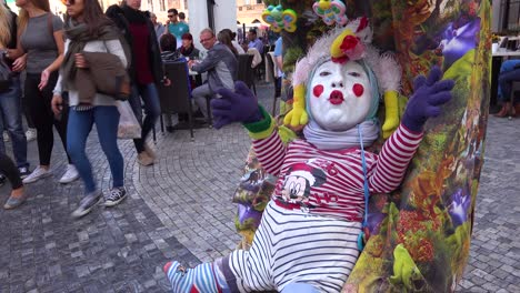 A-strange-street-performing-clown-acts-like-a-baby