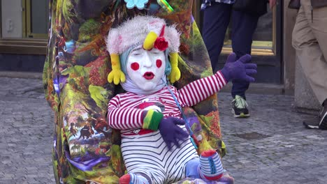 A-strange-street-performing-clown-acts-like-a-baby-1